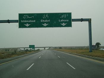 Shown are signs along Pakistan's Motorway, seen as an alternative to its train system.