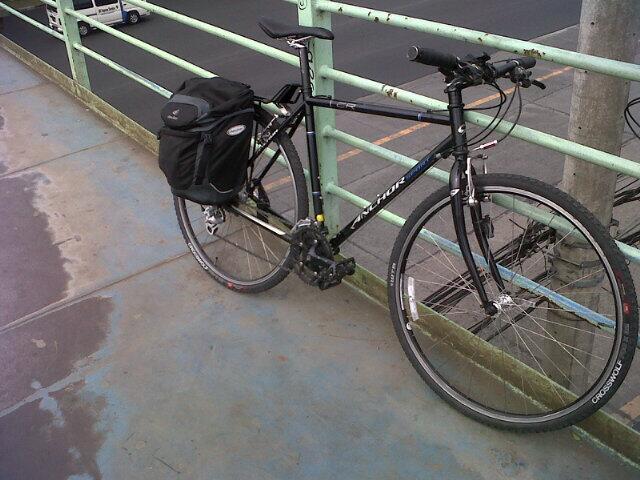 The Black Swan—an Anchor-branded Bridgestone touring bike—photographed on a footbridge along Commonwealth Avenue.