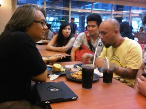Acclaimed independent film director Jim Libiran (left) meets up with flash mob members at SM Megamall.