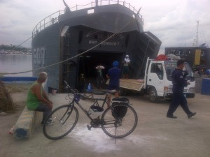 The Black Swan in front of the BRP Benguet at the Tacloban port.